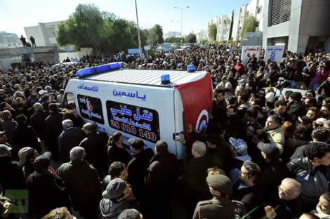 Ambulance carrying Chokri Belaid surrounded by protesters